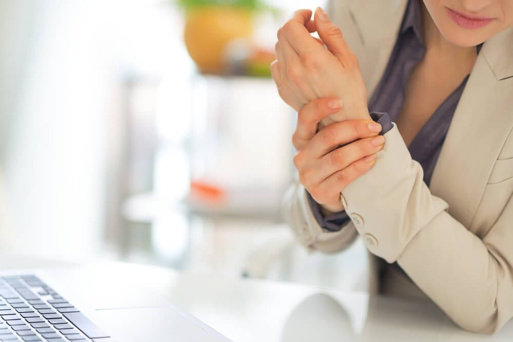 business female with wrist pain